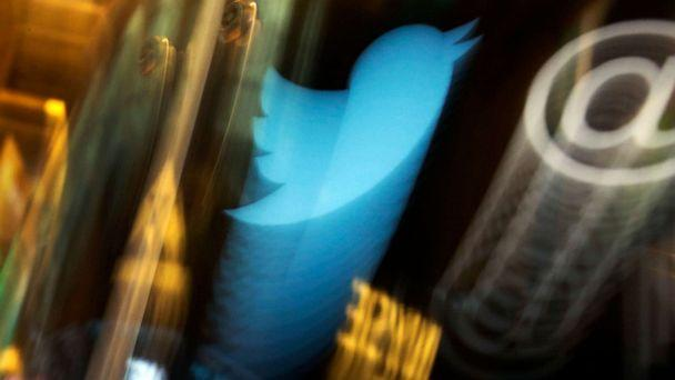 PHOTO: The Twitter logo appears on an updated phone post on the floor of the New York Stock Exchange, Nov. 6 2013. (Richard Drew/AP, FILE)