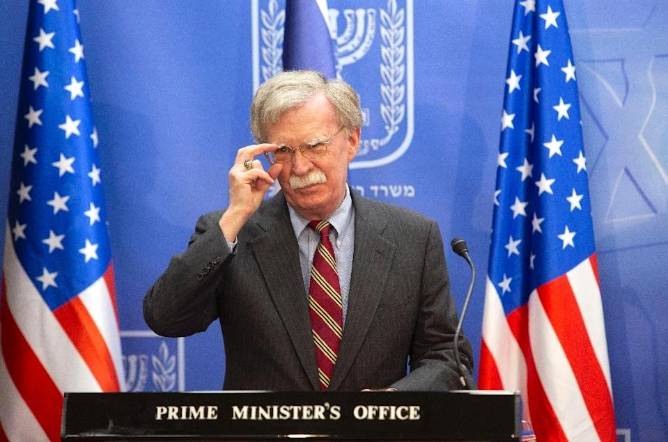 US national security adviser John Bolton adjusts his spectacles as he gives a press conference in Jerusalem on August 20, 2018 (AFP Photo/Sebastian Scheiner)