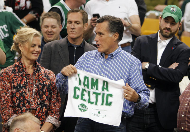 Republican presidential candidate and former Massachusetts Gov. Mitt Romney holds a towel next to his, wife Ann, before an NBA first-round playoff series basketball game between the Boston Celtics and the Atlanta Hawks in Boston, Sunday, May 6, 2012. (AP Photo/Michael Dwyer)