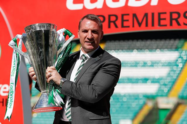 Soccer Football - Scottish Premiership - Celtic vs Aberdeen - Celtic Park, Glasgow, Britain - May 13, 2018 Celtic manager Brendan Rodgers celebrates with the Scottish Premiership trophy after the match REUTERS/Russell Cheyne