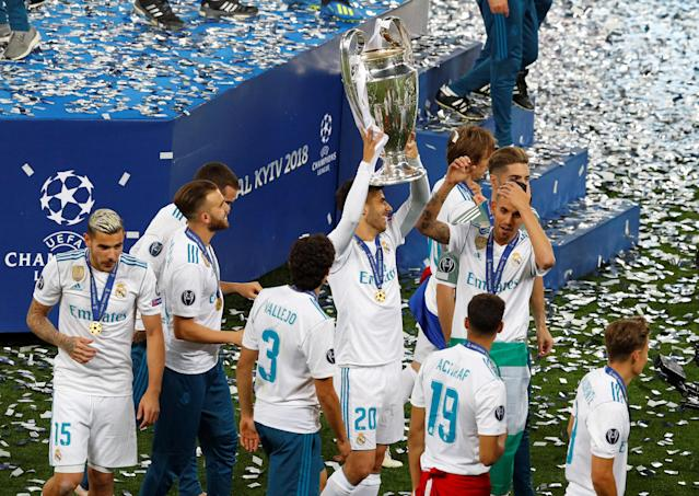 Soccer Football - Champions League Final - Real Madrid v Liverpool - NSC Olympic Stadium, Kiev, Ukraine - May 26, 2018 Real Madrid's Marco Asensio and team mates celebrate winning the Champions League with the trophy REUTERS/Phil Noble