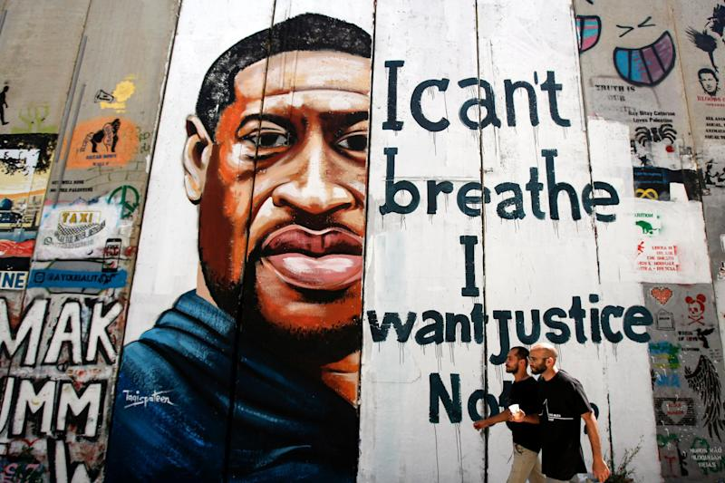 A mural marking the death of George Floyd is painted on a section of Israel's controversial separation barrier in the city of Bethlehem in the occupied West Bank: AFP/Getty