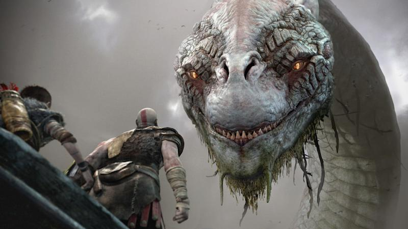 God of War Review | Kratos and Atreus in a boat looking up at a giant hydra-like beast