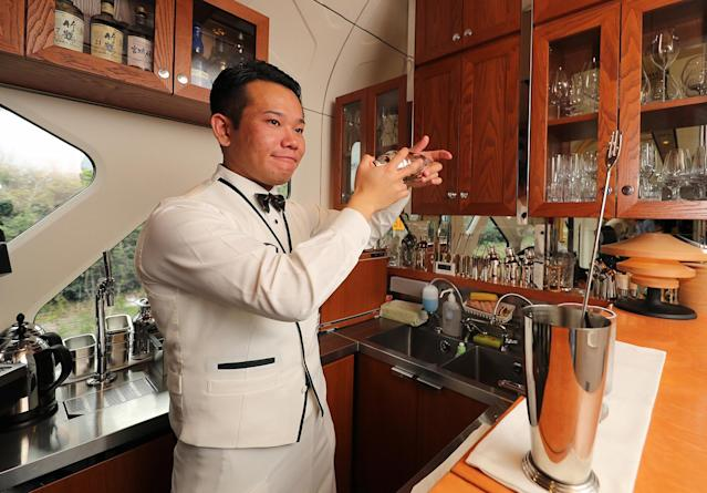 <p>A bartender mixes a cocktail in the lounge. (Photo: The Asahi Shimbun via Getty Images) </p>