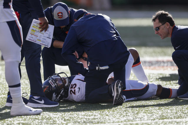 Denver Broncos cornerback Chris Harris (25) lies on the field with an apparent injury in the first half of an NFL football game against the Cincinnati Bengals, Sunday, Dec. 2, 2018, in Cincinnati. (AP Photo/Gary Landers)