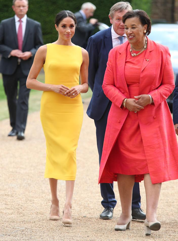 """<div class=""""caption""""> Meghan, Duchess of Sussex accompanied by Commonwealth secretary general Baroness Scotland arrives to attend the Your Commonwealth Youth Challenge reception at Marlborough House on July 05, 2018 in London, England. </div> <cite class=""""credit"""">WPA Pool</cite>"""