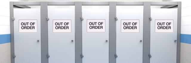 "Restroom stalls, all with ""out of order"" signs."