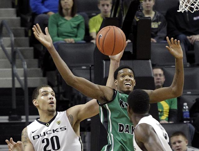 North Dakota forward Jaron Nash, back right, and Oregon center Waverly Austin (20) battle for a rebound during the first half of an NCAA college basketball game in Eugene, Ore., Saturday, Nov. 30, 2013. (AP Photo/Don Ryan)