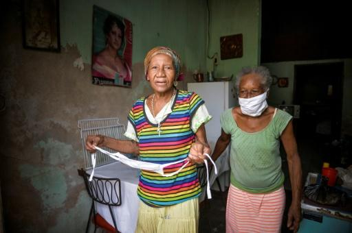 Cuban sisters Olga and Carmen More both suffer from senile dementia but like many elderly they are coping with the coronavirus pandemic