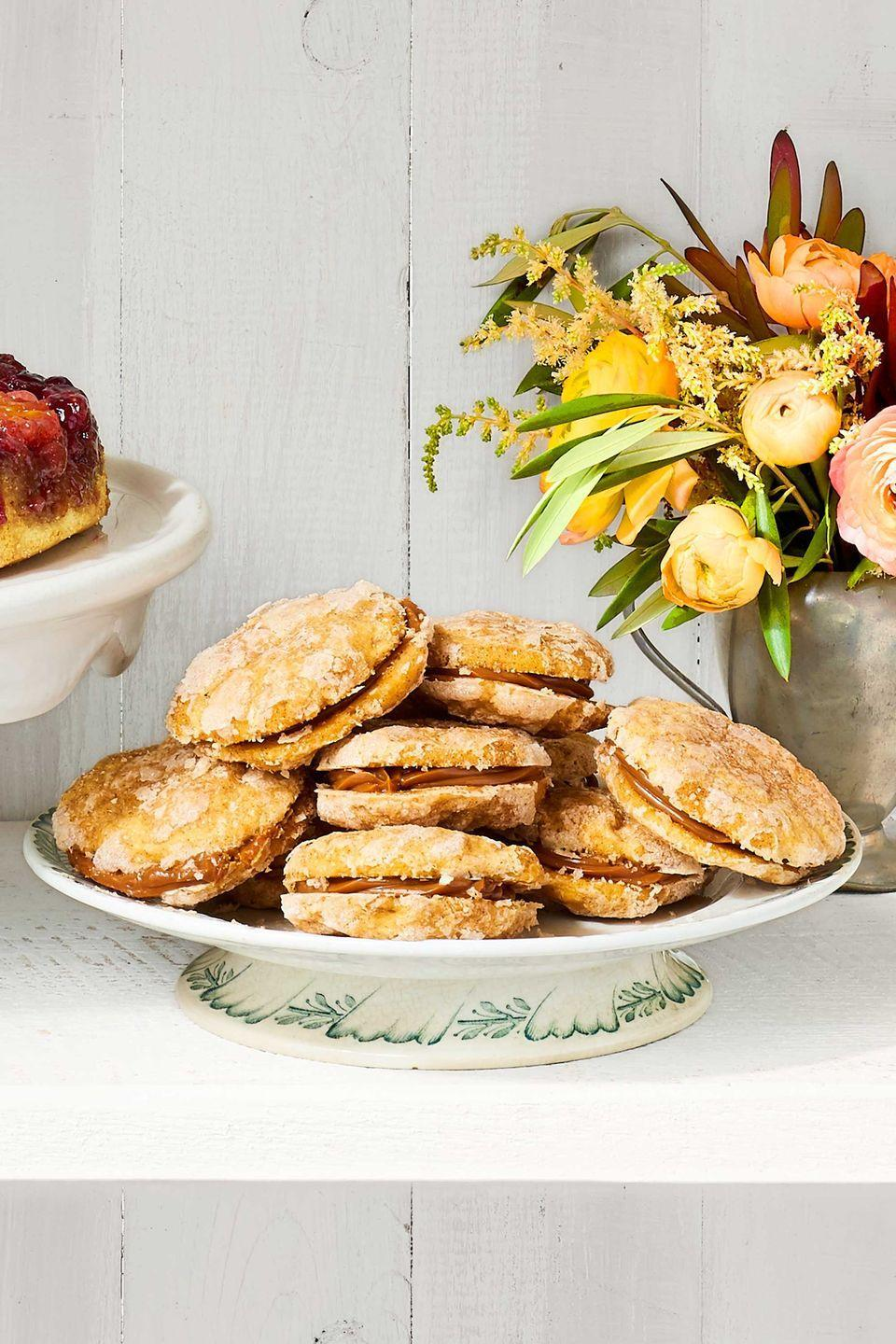 """<p>Satisfy your sweet tooth with these caramel-filled sandwich cookies.</p><p><strong><a href=""""https://www.countryliving.com/food-drinks/recipes/a40046/sweet-potato-snickerdoodles-recipe/"""" rel=""""nofollow noopener"""" target=""""_blank"""" data-ylk=""""slk:Get the recipe"""" class=""""link rapid-noclick-resp"""">Get the recipe</a>.</strong></p>"""