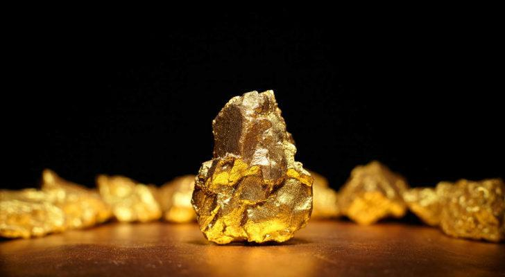 NAK stock Closeup of a large gold nugget. stocks under $10