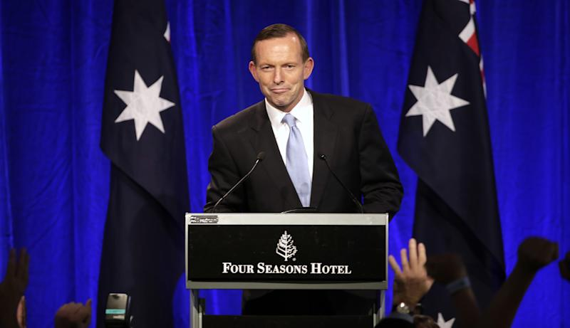 Opposition leader Tony Abbott smiles as he makes a speech to party supporter in Sydney, Saturday, Sept. 7, 2013, following his party's win in Australia's national election. Australia's conservative opposition swept to power, ending six years of Labor Party rule and winning over a disenchanted public by promising to end a hated tax on carbon emissions, boost a flagging economy and bring about political stability after years of Labor infighting. (AP Photo/Rick Rycroft)