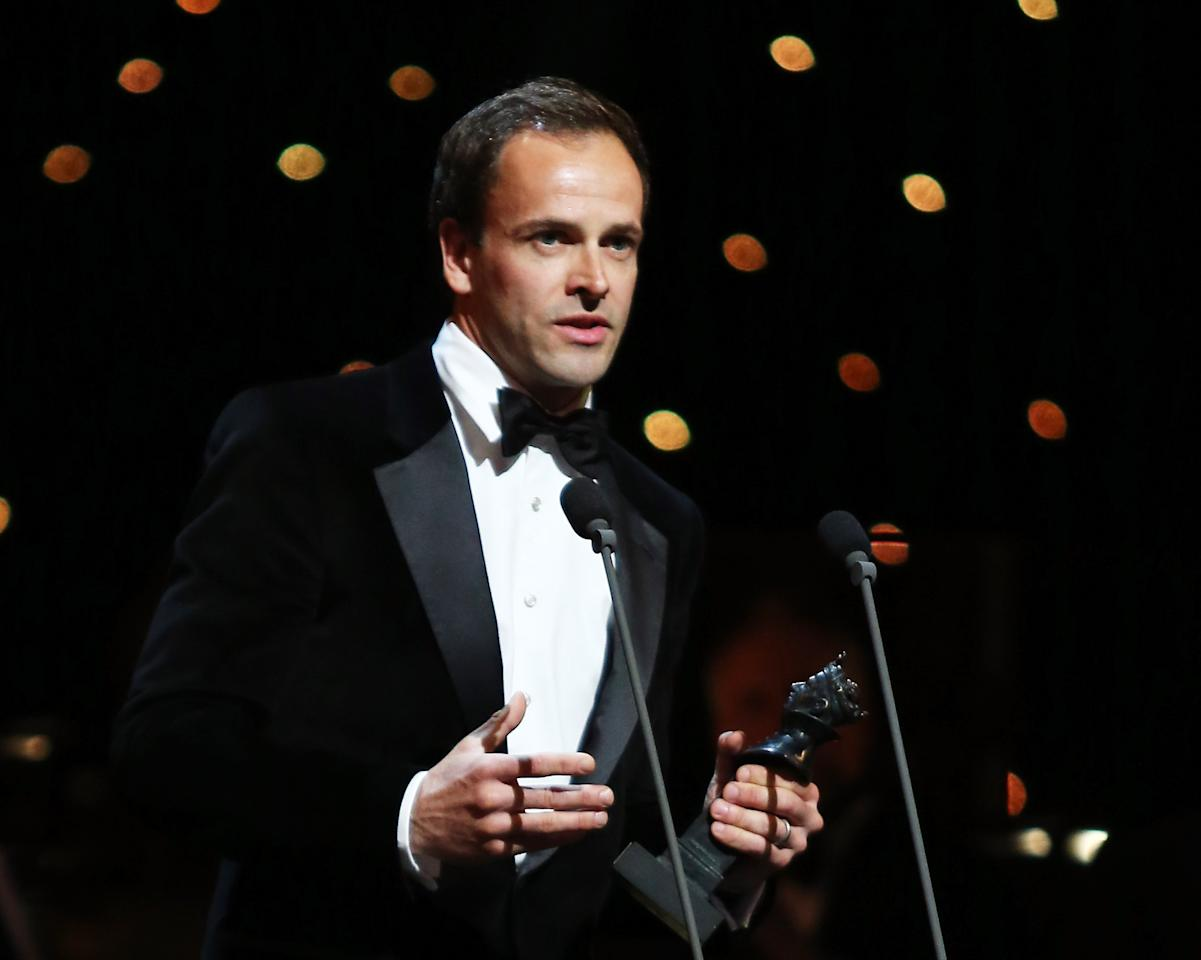 """LONDON, ENGLAND - APRIL 15:  (EXCLUSIVE COVERAGE) Jonny Lee Miller accepts the award for Best Actor for """"Frankenstein"""" at the 2012 Olivier Awards at The Royal Opera House on April 15, 2012 in London, England.  (Photo by Tim Whitby/Getty Images)"""