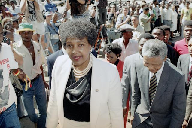 <p>Winnie Mandela, left, wife of African National Congress leader Nelson Mandela, right, arrives at the Johannesburg Supreme Court on Feb. 5, 1991, where Mrs. Mandela is facing charges of kidnapping and assault. (Photo: John Parkin/AP) </p>