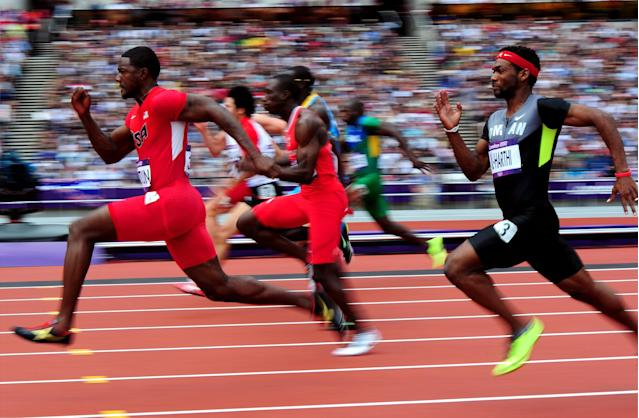 LONDON, ENGLAND - AUGUST 04: Justin Gatlin of the United States (L) competes in the Men's 100m Round 1 Heats on Day 8 of the London 2012 Olympic Games at Olympic Stadium on August 4, 2012 in London, England. (Photo by Stu Forster/Getty Images)