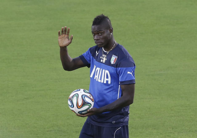 Italy's Mario Balotelli waves prior to a training session of Italy in Natal, Brazil, Saturday, June 21, 2014. Italy plays in group D of the 2014 soccer World Cup. Italy proved ineffective in a 1-0 loss to Costa Rica on Friday and now the Azzurri need a win or a draw against Uruguay on Tuesday to reach the second round. (AP Photo/Antonio Calanni)