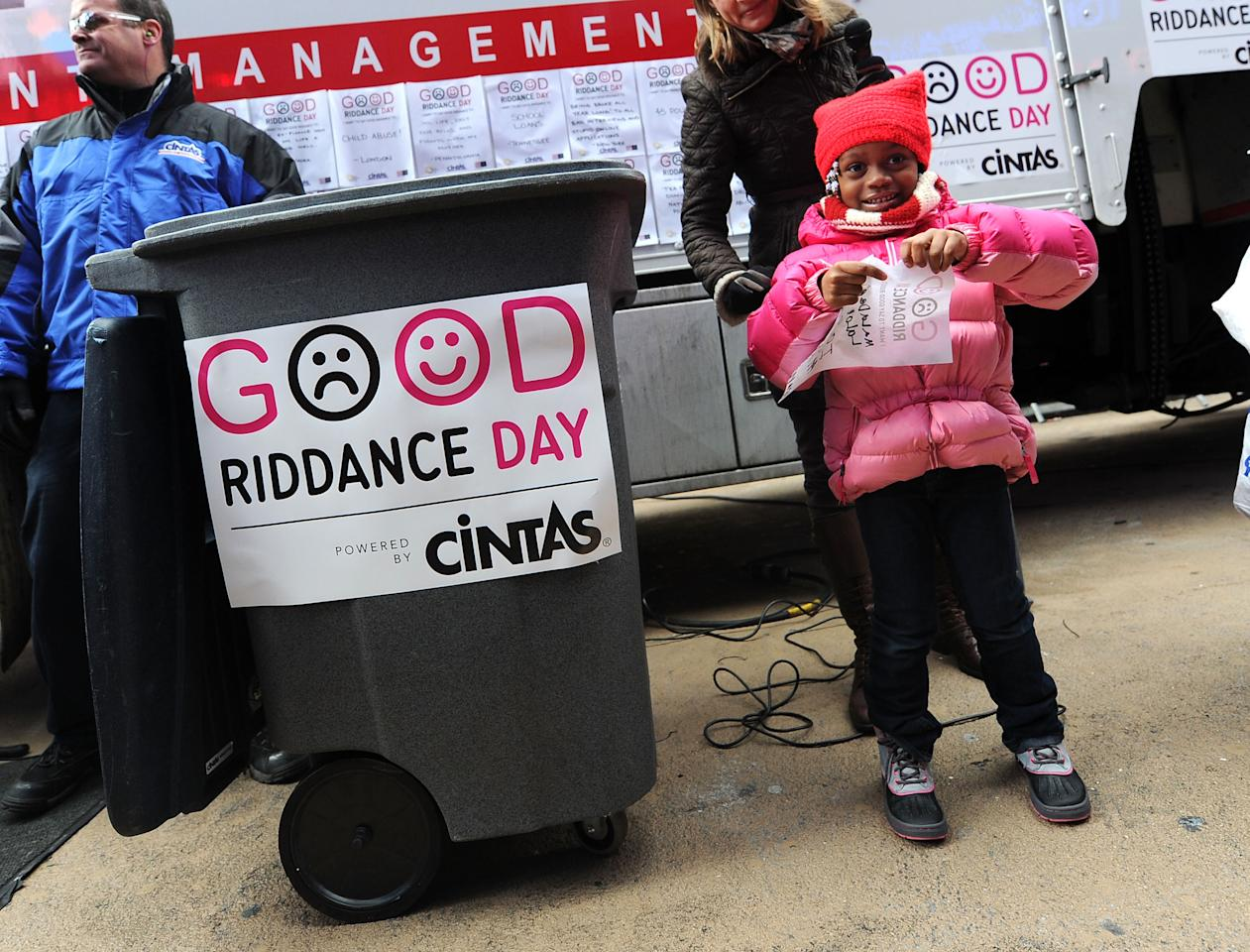 NEW YORK, NY - DECEMBER 28:  Maladee Lalor rips up her old residential address so she can move to a nicer home at the 2011 Good Riddance Day at Times Square on December 28, 2011 in New York City.  (Photo by Jason Kempin/Getty Images)