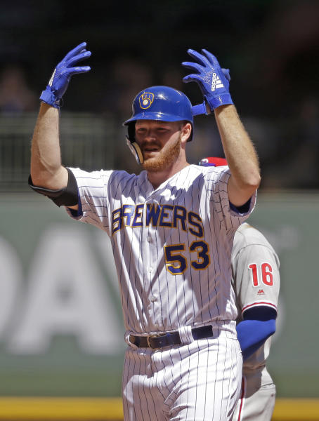 Milwaukee Brewers starting pitcher Brandon Woodruff reacts after his run-scoring double against the Philadelphia Phillies during the fourth inning of a baseball game Sunday, May 26, 2019, in Milwaukee. (AP Photo/Jeffrey Phelps)