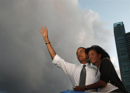 Barack Obama and his wife Michelle attend a campaign rally at Bicentennial Park in Miami, Florida, October 21, 2008.