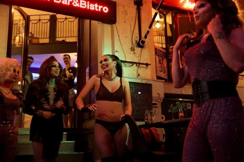 Transgender woman Daniella Milla Tokodi smiles during a drag queen show at a bar in Budapest