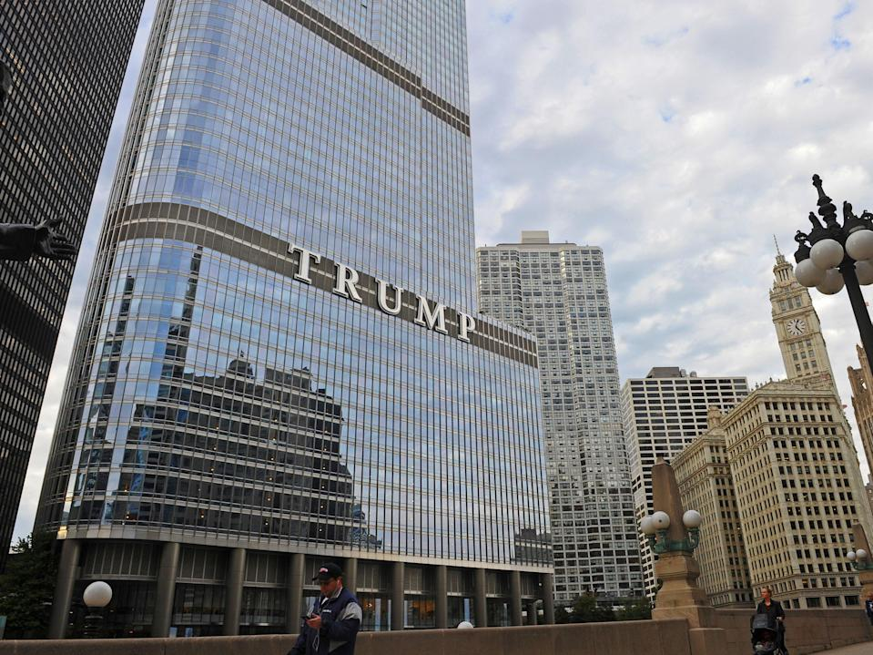 <p>A man walks in front of the Trump Tower in Chicago, Illinois on 7 October 2016</p> ((AFP via Getty Images))