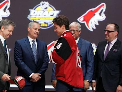 Jun 24, 2016; Buffalo, NY, USA; Clayton Keller puts on a team jersey after being selected as the number seven overall draft pick by the Arizona Coyotes in the first round of the 2016 NHL Draft at the First Niagra Center. Mandatory Credit: Timothy T. Ludwig-USA TODAY Sports