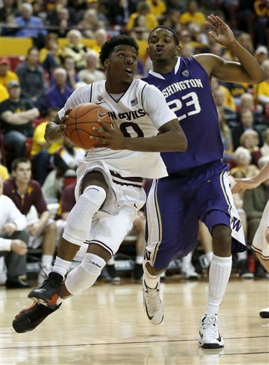 Arizona State's Carrick Felix (0) drives against Washington's C.J. Wilcox (23) during the second half of an NCAA college basketball game, Saturday, Feb. 23, 2013, in Tempe, Ariz. (AP Photo/Matt York)