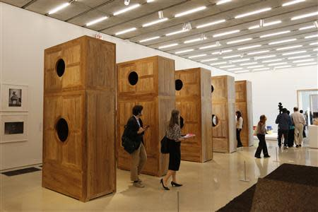 """Journalists view a work titled """"Moon Chest"""" by artist Ai Weiwei of China during a media tour of the Perez Art Museum Miami (PAMM) in Miami, Florida December 3, 2013. REUTERS/Joe Skipper"""