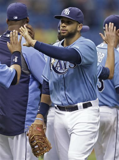 Tampa Bay Rays' James Loney high fives teammates after the Rays defeated the New York Yankees 8-3 during a baseball game Sunday, May 26, 2013, in St. Petersburg, Fla. (AP Photo/Chris O'Meara)