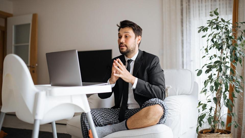 Young businessman at home.