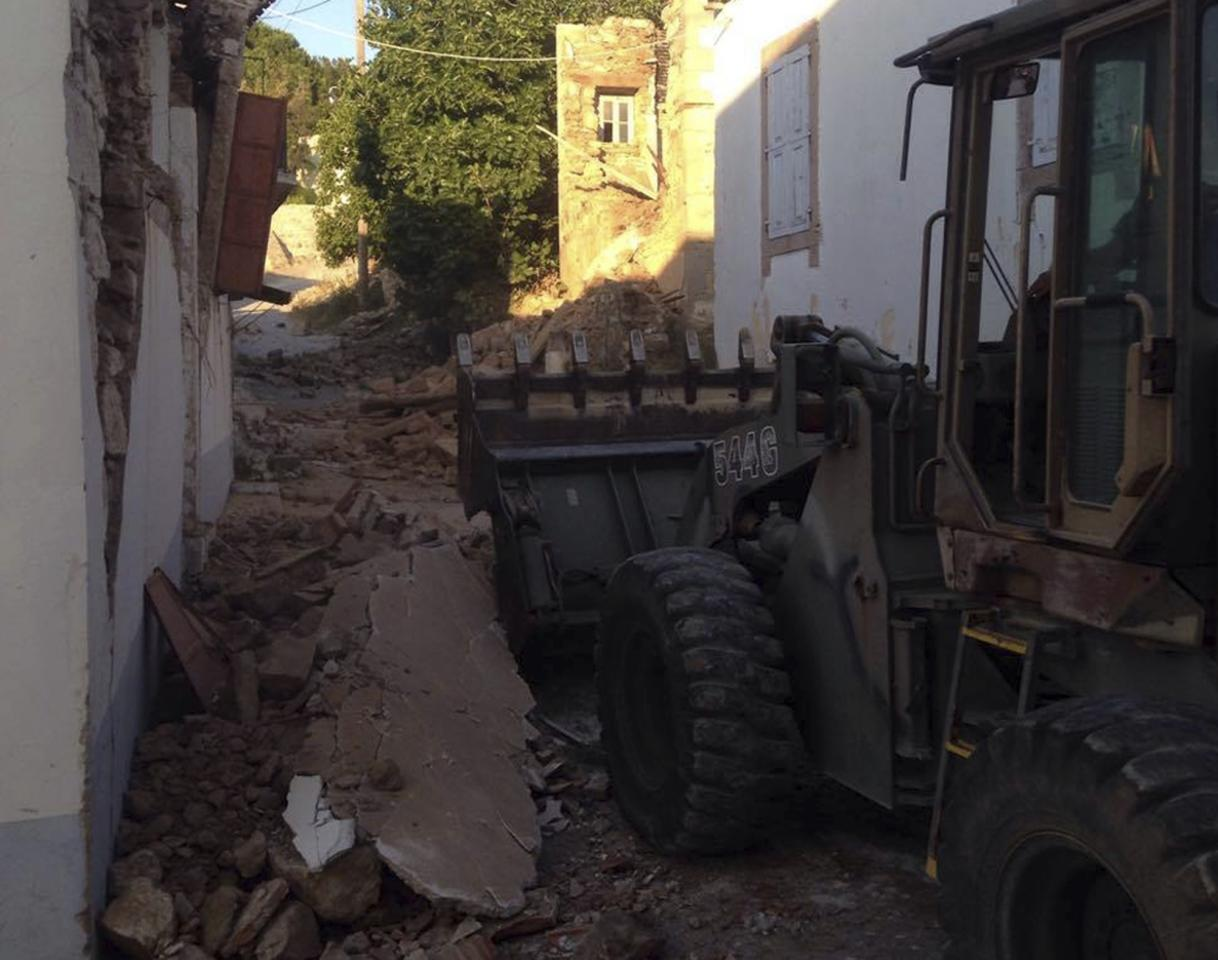 <p>A bulldozer removes the debris of a damaged building after an earthquake in the village of Vrissa on the northeastern Greek island of Lesbos. (AP Photo/Apostolis Paraskevopoulos) </p>