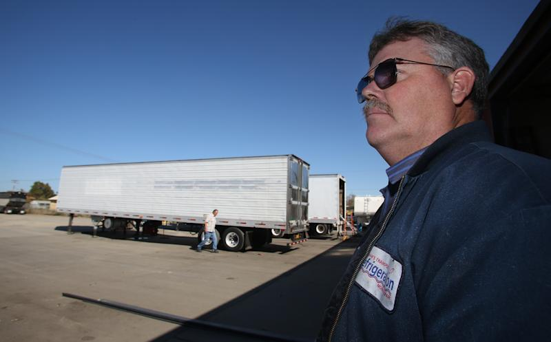 In this photo taken Oct. 25, 2012, Kelly Cox, co-owner of Shehan's Transport Refrigeration is seen in Delhi, Calif. Who are these people who still can't make up their minds? They're undecided voters like Cox, who spends his days repairing the big rigs that haul central California's walnuts, grapes, milk and much more across America. He doesn't put much faith in Barack Obama or Mitt Romney. (AP Photo/Gary Kazanjian)