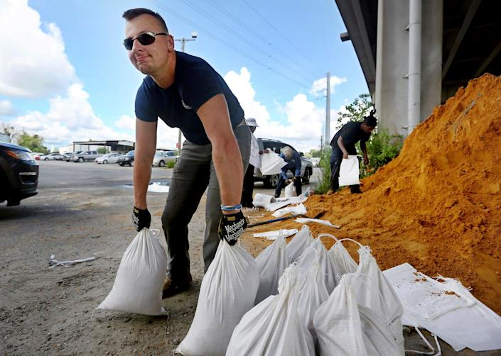 Kevin Orth loads sandbags into cars on Milford Street as he helps residents prepare for Hurricane Florence inin Charleston, South Carolina, on Monday, Sept. 10.