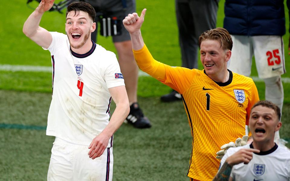 Jordan Pickford (right) and Declan Rice celebrate victory over Germany - GETTY IMAGES