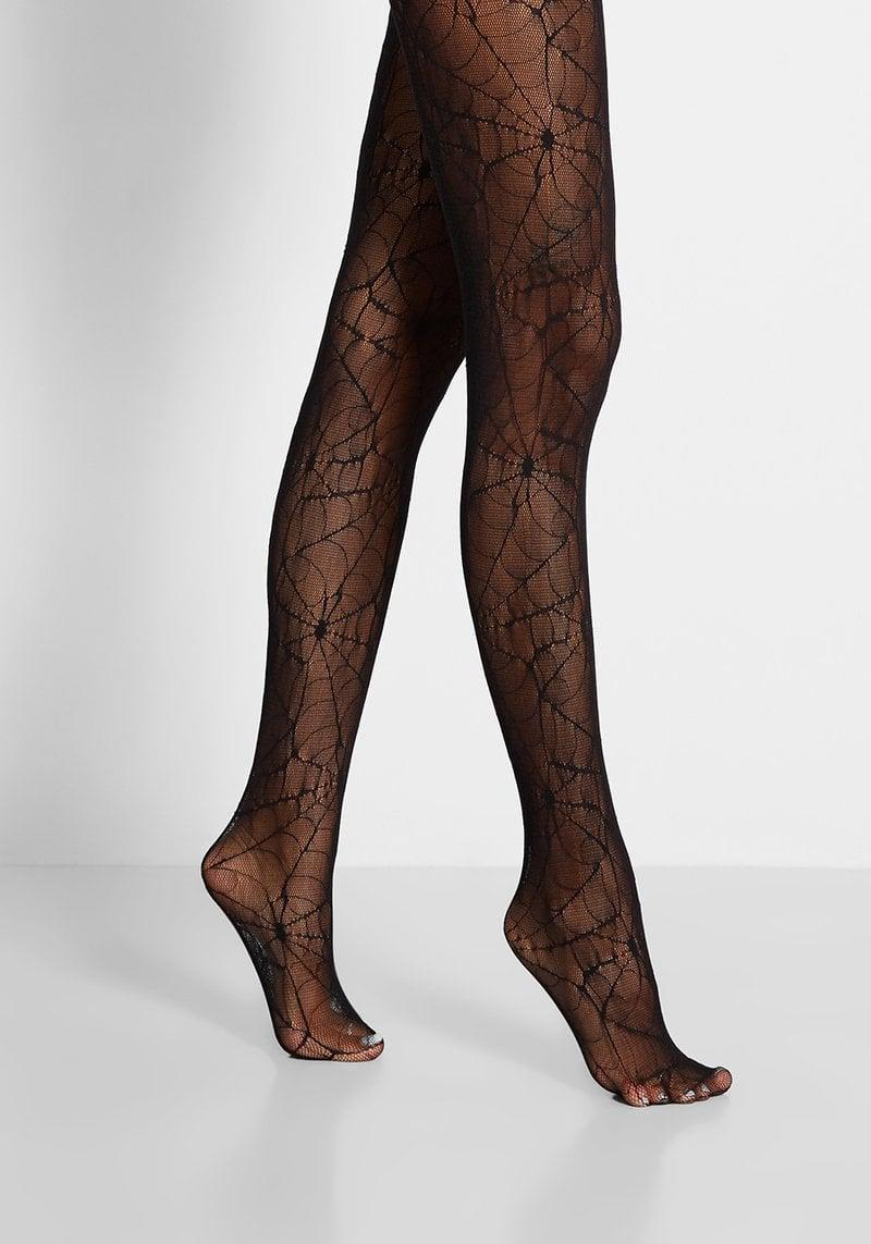 """<p>Give any dress or skirt a haunting edge with these <span>Spooky Spiderwebs Tights</span> ($25). It's creepy web-like design is such a cute detail that's perfect for not only costumes but even giving your trendy dresses and skirts a <a class=""""link rapid-noclick-resp"""" href=""""https://www.popsugar.com/Halloween"""" rel=""""nofollow noopener"""" target=""""_blank"""" data-ylk=""""slk:Halloween"""">Halloween</a> makeover. </p>"""