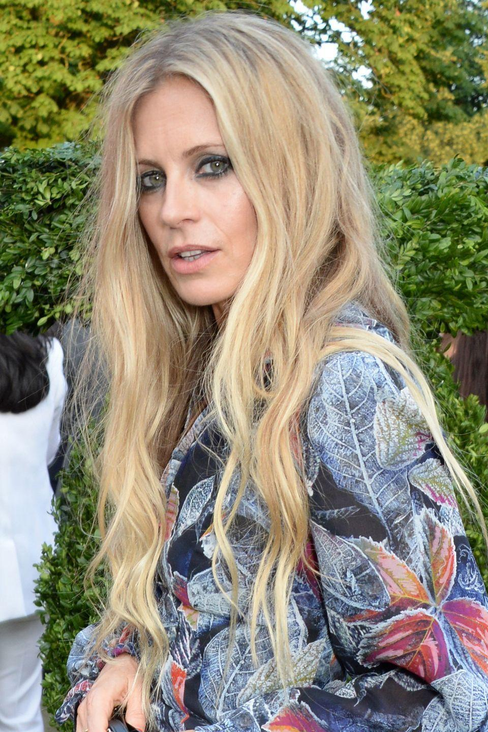 <p>Laura Bailey proves that long waves don't have to be overly styled to look grown-up. Embrace a little fuzziness by changing the direction in which you use your curling iron and run your hands through your hair afterwards so the curls aren't perfect.</p>