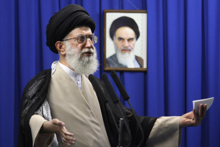 FILE - In this June 19, 2009 file photo, Iran's Supreme Leader Ayatollah Ali Khamenei delivers a sermon with a picture of the late spiritual leader Ayatollah Khomeini in the background, during Friday prayers at the Tehran University campus in Tehran, Iran. Khamenei was among the first and most powerful world leaders to suggest the coronavirus could be a biological weapon created by the U.S. (Meisam Hosseini/Hayat News Agency via AP, File)