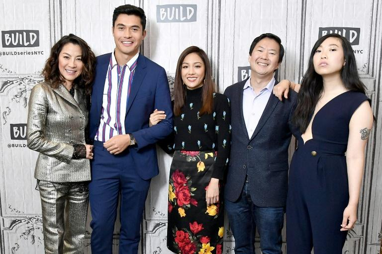 "L-R: Actors Michelle Yeoh, Henry Golding, Constance Wu, Ken Jeong and Nora Lum, aka Awkwafina promote the film ""Crazy Rich Asians"" on August 14, 2018 in New York City"