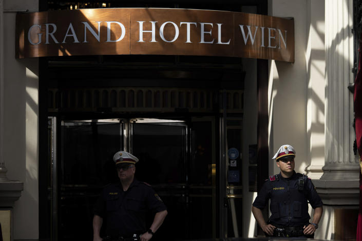 Police officers stand in front of the 'Grand Hotel Vienna' where where closed-door nuclear talks take place in Vienna, Austria, Saturday, June 12, 2021. (AP Photo/Florian Schroetter)