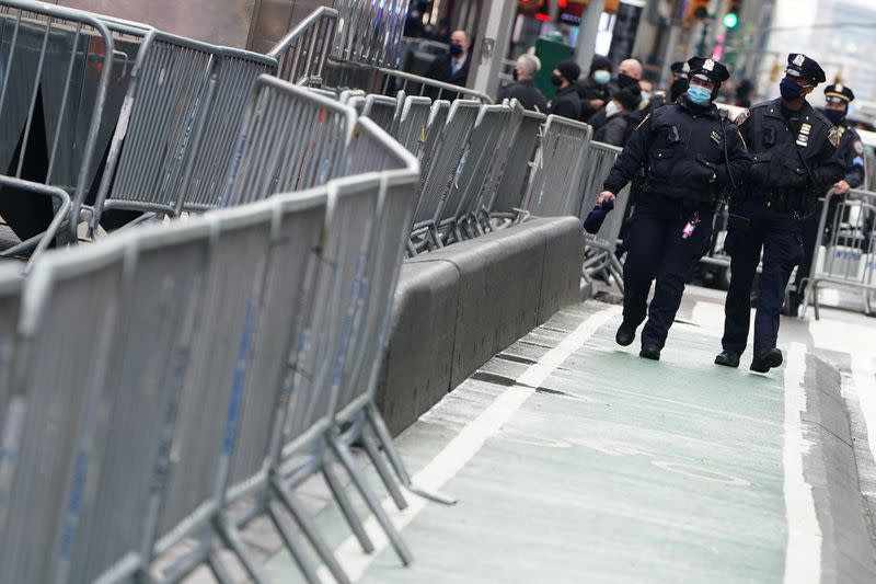 Police walk checkpoints to prevent people from entering Times Square ahead of New Year's Eve