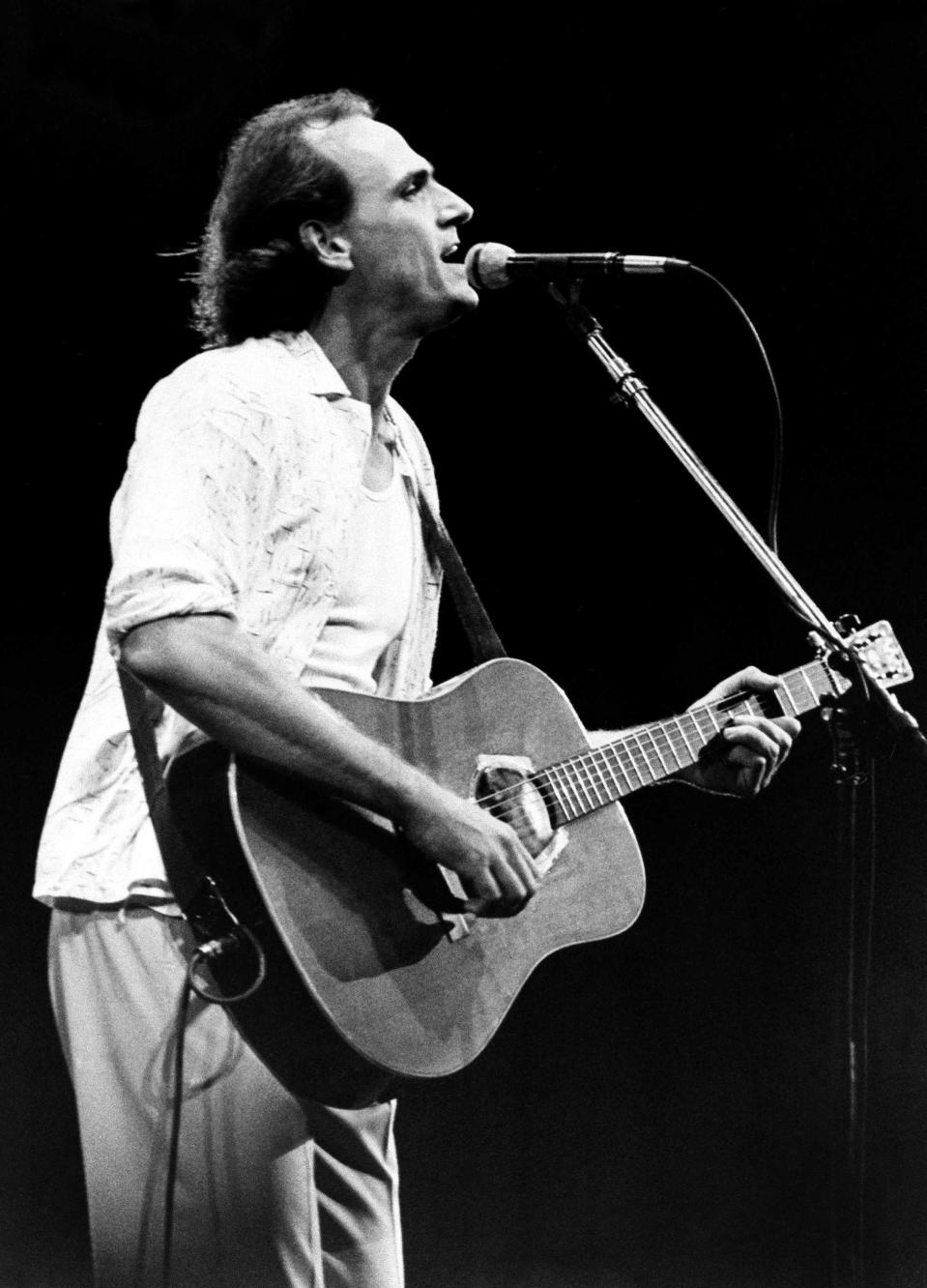 American folk rock singer James Taylor performs at night on Saturday, Jan. 13, 1985 at Rio de Janeiro's Rock in Rio festival. Billod as the biggest rock music festival ever, the ten-day event features 29 European, American, Australian and Brazilia groups. (AP Photo)