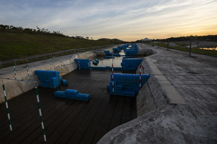The sun sets over the Olympic canoe slalom circuit at Radical Park in Rio de Janeiro, Brazil, Thursday, June 24, 2021. With the Olympics about to kick off in Tokyo, the prior host is struggling to make good on legacy promises. (AP Photo/Bruna Prado)