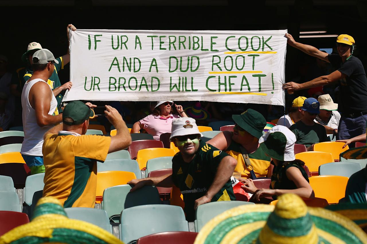 BRISBANE, AUSTRALIA - NOVEMBER 23:  Spectators in the crowd hold up a sign using the names of Alastair Cook, Joe Root and Stuart Broad of England during day three of the First Ashes Test match between Australia and England at The Gabba on November 23, 2013 in Brisbane, Australia.  (Photo by Mark Kolbe/Getty Images)