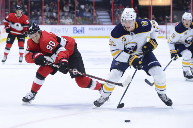 Buffalo Sabres defenseman Rasmus Ristolainen (55) skates with the puck as Ottawa Senators left wing Vladislav Namestnikov (90) attempts to get it during the second period of an NHL hockey game Monday, Dec. 23, 2019, in Ottawa, Ontario. (Sean Kilpatrick/The Canadian Press via AP)