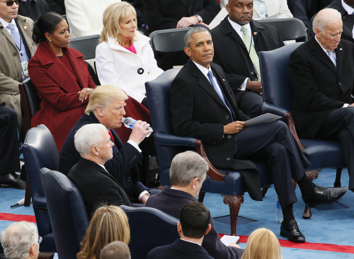 <p>President Barak Obama looks over at President-Elect Donald Trump who takes a drink of water before getting up to take the oath of office at the inauguration ceremonies swearing in Donald Trump as the 45th president of the United States on the West front of the U.S. Capitol in Washington on Jan. 20, 2017. (Photo: Rick Wilking/Reuters) </p>