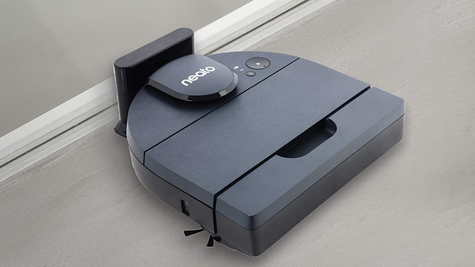 The Neato D8 has a D-shaped design so that it can go flush against walls to suck up all the dirt that falls along the baseboards.