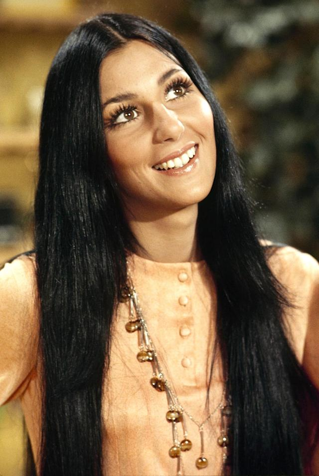 """<p>Although the Oscar winner has used wigs throughout her six decades in showbiz, she confirmed in a 2013 Facebook chat that her natural hair is still <a href=""""http://www.cnn.com/2013/11/03/showbiz/cher-facebook-fan-questions/"""" rel=""""nofollow noopener"""" target=""""_blank"""" data-ylk=""""slk:""""black and long."""""""" class=""""link rapid-noclick-resp"""">""""black and long.""""</a> Fun fact: She has also noted that <a href=""""http://www.bravotv.com/watch-what-happens-live/season-10/videos/after-show-cher-on-hair"""" rel=""""nofollow noopener"""" target=""""_blank"""" data-ylk=""""slk:her hair during her Sonny and Cher days"""" class=""""link rapid-noclick-resp"""">her hair during her Sonny and Cher days</a> was all real. (Photo: ABC Photo Archives/ABC via Getty Images) </p>"""
