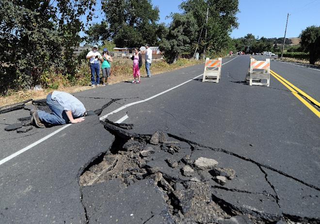 Buckled highway outside of Napa, CA in Aug. 2014. AFP Photo/Josh Edelson