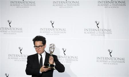 Producer J.J. Abrams poses for photographers with his Founders Award backstage during the 41st International Emmy Awards in New York