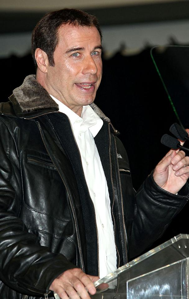 "John Travolta is the subject of an ""explosive tell-all"" being written by one of his relatives, reports the National Enquirer, which adds the ""bombshell book"" will expose ""all of his dirty laundry."" For what sordid secrets the tell-all will reveal, and how Travolta's fighting to stop its publication, see what a family insider spills to <a target=""_blank"" href=""http://www.gossipcop.com/john-travolta-tell-all-book-relative-sex-scandal-personal-life/"">Gossip Cop</a>."